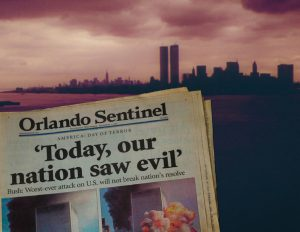 Orlando sentinel Paper with Twin Towers in background.